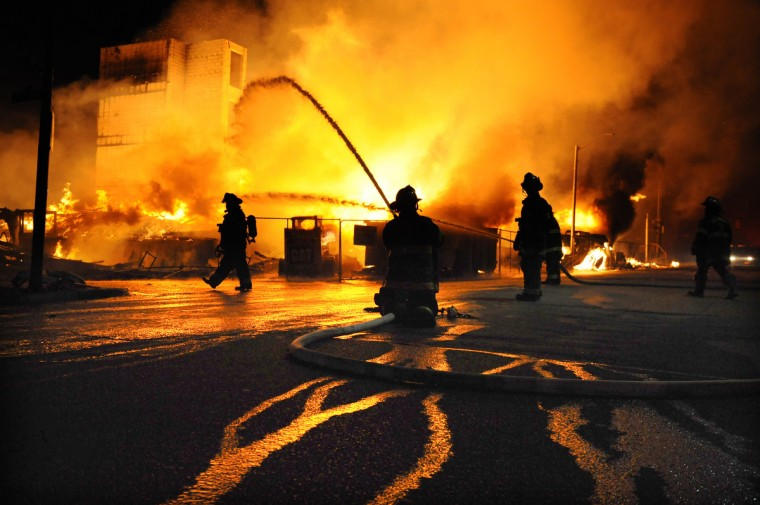 Baltimore firefighters battle a three-alarm fire at Gay and Chester Streets in East Baltimore during an afternoon and evening of rioting in the city. (Jerry Jackson/Baltimore Sun)