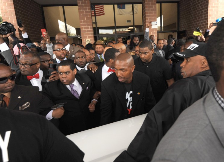 The crowd presses in as the casket for Freddie Gray is moved towards the hearse during his funeral at New Shiloh Baptist Church on April 27. (Algerina Perna/Baltimore Sun)