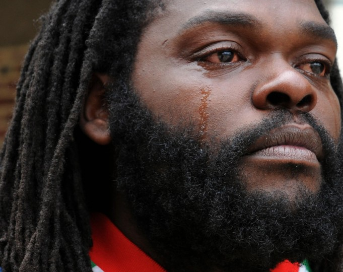 Kevin Moore is overwhelmed with joy on the news of the charges brought against six Baltimore police officers in the death of Freddie Gray. Moore's video of Gray's arrest at Gilmor Homes has been seen around the world. (Jerry Jackson/Baltimore Sun)