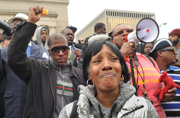 Angela Hazel is overcome with emotion at a protest rally led by Rev. Jamal Bryant of the Empowerment Temple AME Church at War Memorial Plaza Thursday, April 23.  (Amy Davis/ Baltimore Sun)