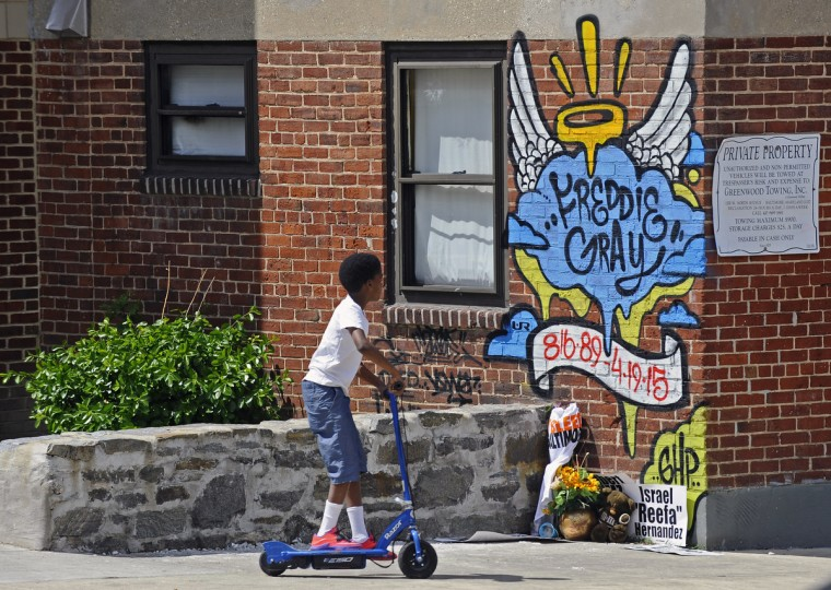 A child from the Gilmor Homes neighborhood play near the area where Freddie Gray was arrested on April 12, 2015, now marked with a mural. About 500 people marched to Baltimore City Hall to join the National Rally at 2 p.m. (Kenneth K. Lam/Baltimore Sun)
