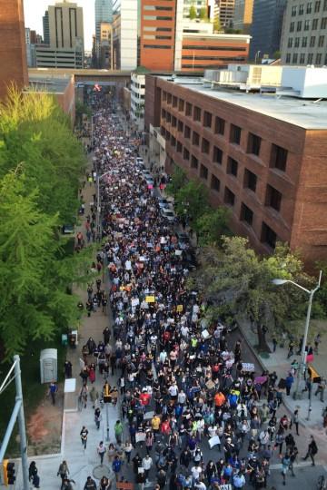 Freddie Gray protesters march along Calvert Street near the intersection with Centre Street in Baltimore.  (Robert K. Hamilton/Baltimore Sun)