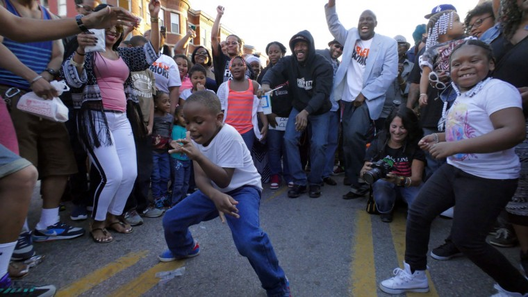 Dilan Price, 7 dances as people enjoy another day of celebration on North Avenue near Pennsylvania following the announcement of charges against six police officers in the fatal arrest of Freddie Gray. The city state's attorney yesterday announced charges against six officers who confronted and then placed Gray into custody on April 12, eventually resulting in what was ruled a homicide of the 25-year-old West Baltimore resident seven days later. (Karl Merton Ferron/Baltimore Sun)