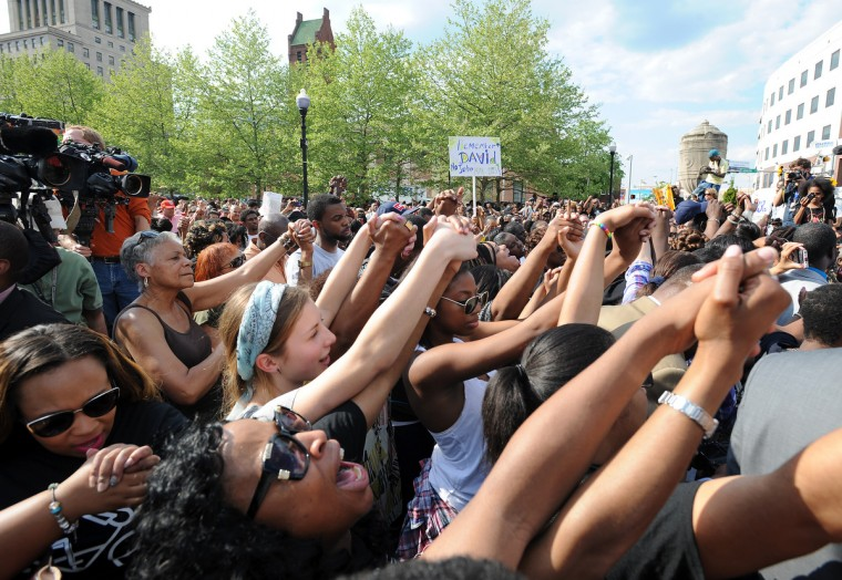 The crowd raises their hands in prayer and victory on Sunday, May 3.  Members of the clergy held a interfaith rally on the War Memorial Plaza Sunday after a week of turmoil following the police custody death of Freddie Gray. (Paul W. Gillespie/Baltimore Sun)