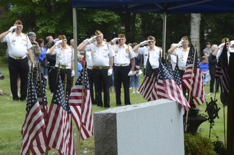 Pittsfield VFW Post 448 members salute during Memorial Day exercises in the Pittsfield Cemetery in Pittsfield, Mass. on Monday, May, 25, 2015. (Gillian Jones/The Berkshire Eagle via AP)