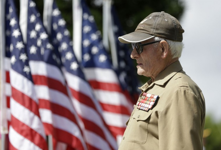 Veteran Zalman Greenberg, 90, of North Miami Beach, listens during a Memorial Day event in honor of veterans who died in service to the country, Monday, May 25, 2015, in North Miami Beach, Fla. Greenberg, who is Russian, fought with Russia against the Nazis in WWII. (AP Photo/Lynne Sladky)