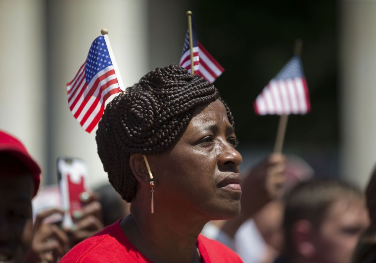 Sandra Bacchus of Coram, N.Y., listens as President Barack Obama speaks in the Memorial Amphitheater at Arlington National Cemetery in Arlington, Va., Monday, May 25, 2015, during a Memorial Day ceremony. (AP Photo/Pablo Martinez Monsivais)