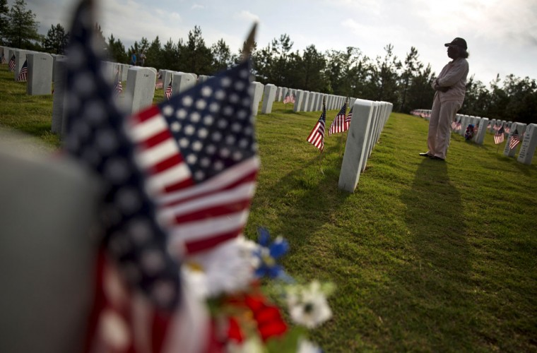 Lucille Williams visits the grave of her late husband, Korean War veteran Sfc. Alvin Williams, at Georgia National Cemetery on Memorial Day, Monday, May 25, 2015, in Canton, Ga. (AP Photo/David Goldman)