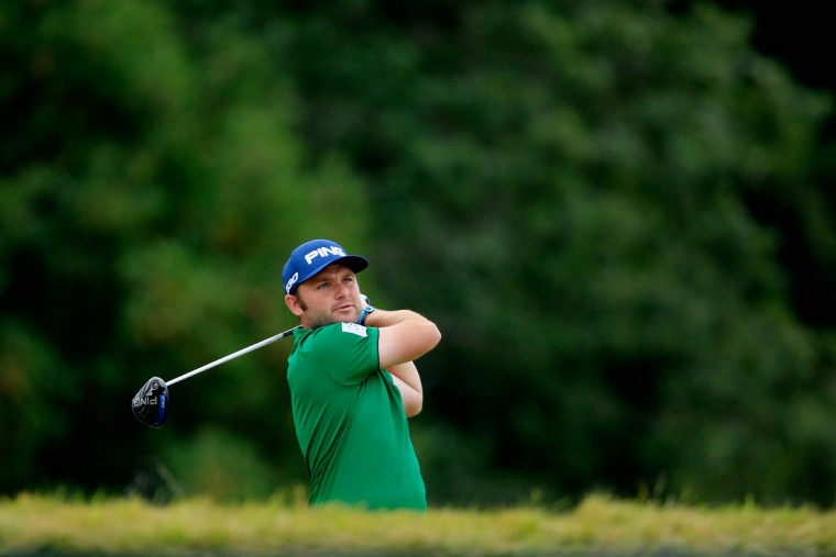 Andy Sullivan of England hits his tee shot on the 14th hole during the first round of the 115th U.S. Open Championship at Chambers Bay on June 18, 2015 in University Place, Washington. (Photo by David Cannon/Getty Images)