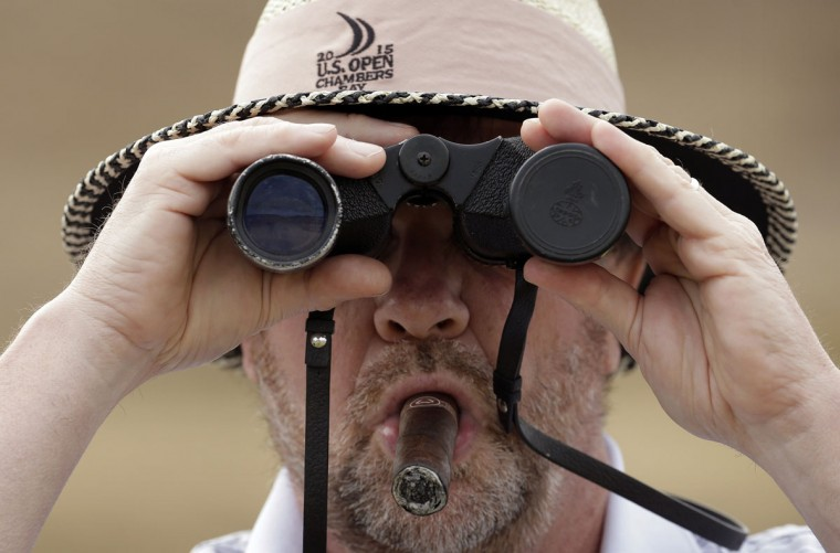Paul Heine watches play on the 10th hole during the first round of the U.S. Open golf tournament at Chambers Bay, Thursday, June 18, 2015, in University Place, Wash. (AP Photo/Charlie Riedel)
