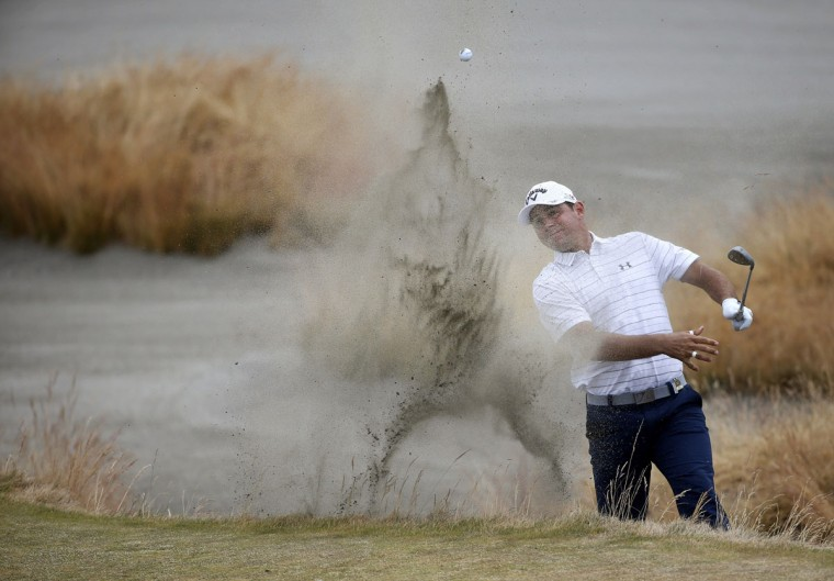 Gary Woodland hits out of the bunker on the 15th hole during the first round of the U.S. Open golf tournament at Chambers Bay on Thursday, June 18, 2015 in University Place, Wash. (AP Photo/Lenny Ignelzi)