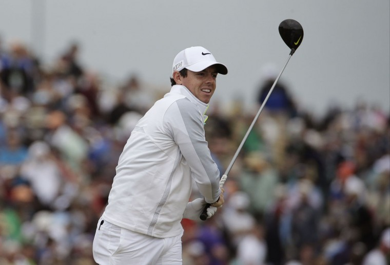 Rory McIlroy watches his tee shot on the 12th hole during the first round of the U.S. Open golf tournament at Chambers Bay on Thursday, June 18, 2015 in University Place, Wash. (AP Photo/Charlie Riedel)