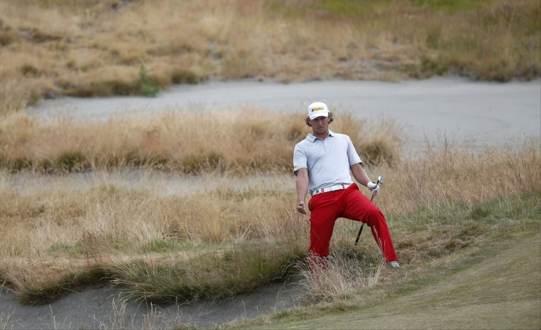 Marcel Siem, of Germany, reacts to his bunker shot on the 16th hole during the first round of the U.S. Open golf tournament at Chambers Bay on Thursday, June 18, 2015 in University Place, Wash. (AP Photo/Lenny Ignelzi)