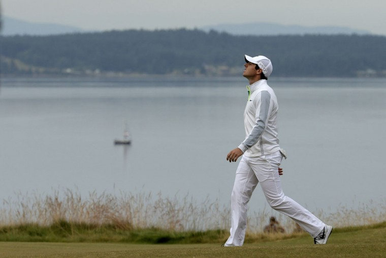 Rory McIlroy walks to the 13th green during the first round of the U.S. Open golf tournament at Chambers Bay on Thursday, June 18, 2015 in University Place, Wash. (AP Photo/Charlie Riedel)