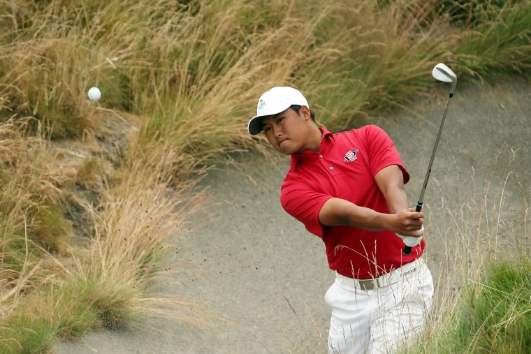 Amateur Gunn Yang of Korea plays a bunker shot on the tenth hole during the first round of the 115th U.S. Open Championship at Chambers Bay on June 18, 2015 in University Place, Washington. (Photo by Mike Ehrmann/Getty Images)
