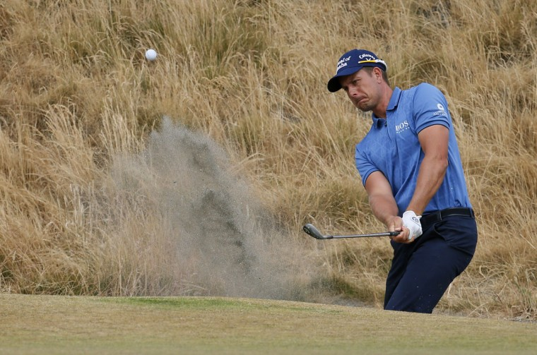 Henrik Stenson, of Sweden, hits out of the bunker on the sixth hole during the first round of the U.S. Open golf tournament at Chambers Bay on Thursday, June 18, 2015 in University Place, Wash. (AP Photo/Matt York)