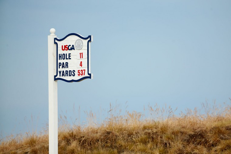 A tee sign is shown on the 11th hole during the first round of the 115th U.S. Open Championship at Chambers Bay on June 18, 2015 in University Place, Washington. (Photo by Mike Ehrmann/Getty Images)