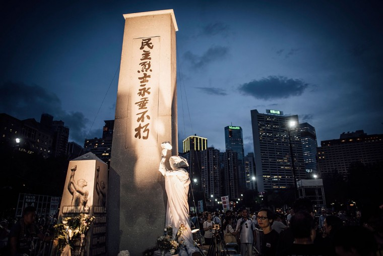 Participants holds candles and placards at Victoria Park on June 4, 2015 in Causeway Bay, Hong Kong. Hong Kong residents held a candlelight vigil as it marks 26th anniversary of 1989 student-led Tiananmen Square protest. (Photo by Anthony Kwan/Getty Images)