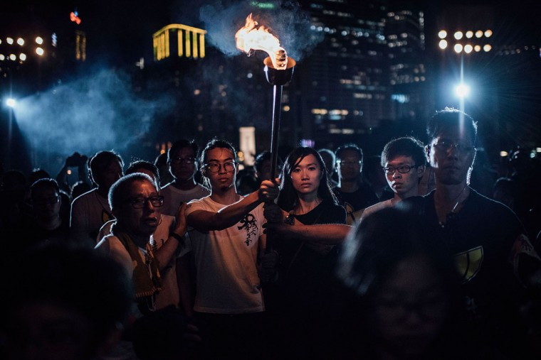 Participants take part at the candlelight vigil as they hold candles at Victoria Park on June 4, 2015 in Causeway Bay, Hong Kong. Hong Kong residents held a candlelight vigil as it marks 26th anniversary of 1989 student-led Tiananmen Square protest. (Photo by Anthony Kwan/Getty Images)