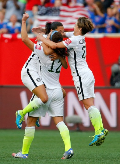 Christen Press #23 celebrates with Lauren Holiday #12 and Meghan Klingenberg #22 of the United States after Press scores a second half goal against Australia during the FIFA Women's World Cup 2015 Group D match at Winnipeg Stadium on June 8, 2015 in Winnipeg, Canada. (Kevin C. Cox/Getty Images)