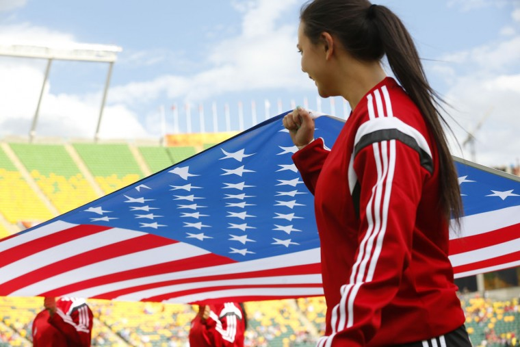 The American flag is carried ahead of Team USA during the FIFA Women's World Cup Canada Round 16 match between USA and Columbia at Commonwealth Stadium on June 22, 2015 in Edmonton, Alberta, Canada. (Todd Korol/Getty Images)