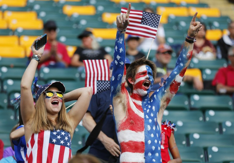 American fans cheer during the FIFA Women's World Cup Canada Round 16 match between USA and Columbia at Commonwealth Stadium on June 22, 2015 in Edmonton, Alberta, Canada. (Todd Korol/Getty Images)