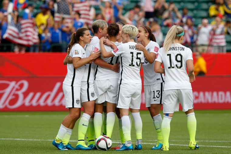 Carli Lloyd #10 of the United States celebrates with teammates after scoring a goal on a penalty kick in the second half against Colombia in the FIFA Women's World Cup 2015 Round of 16 match at Commonwealth Stadium on June 22, 2015 in Edmonton, Canada. (Todd Korol/Getty Images)