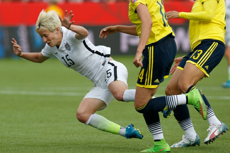 Megan Rapinoe #15 of the United States is taken down as a penalty kick is awarded in the second half against Colombia in the FIFA Women's World Cup 2015 Round of 16 match at Commonwealth Stadium on June 22, 2015 in Edmonton, Canada. (Todd Korol/Getty Images)