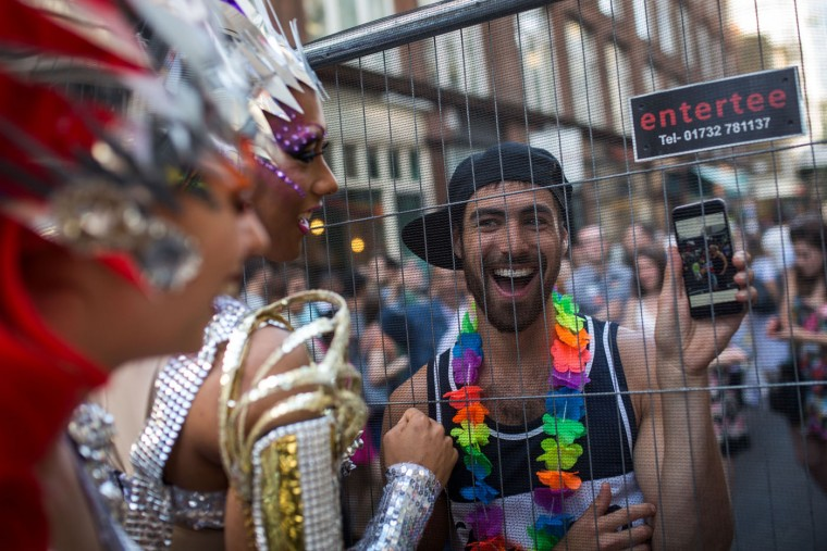 A man talks to cabaret artists preparing to perform at a Pride in London event on June 27, 2015 in London, England. Pride in London is one of the world's biggest LGBT+ celebrations as thousands of people take part in a parade and attend performances at various locations across the city. (Rob Stothard/Getty Images)