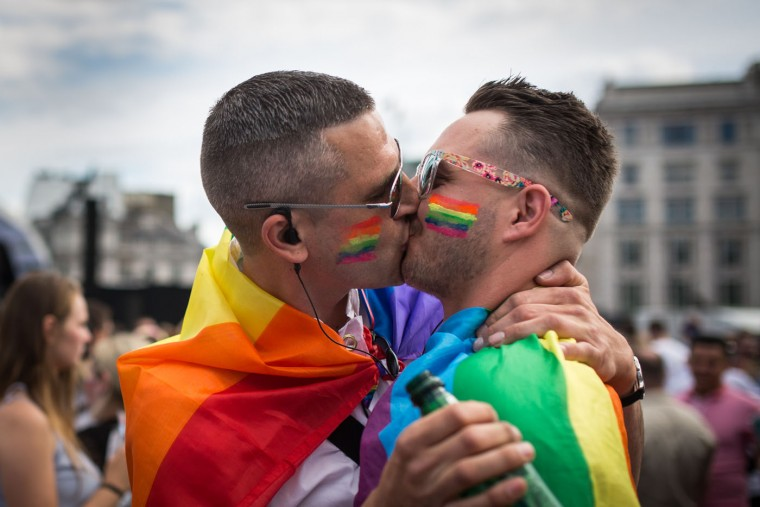 A couple kiss in Trafalgar Square after the annual Pride in London Parade on June 27, 2015 in London, England. Pride in London is one of the world's biggest LGBT+ celebrations as thousands of people take part in a parade and attend performances at various locations across the city. (Rob Stothard/Getty Images)