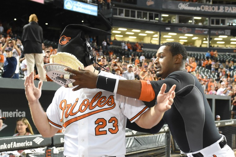 June 2015: Adam Jones #10 of the Baltimore Orioles puts a pie in the face of Travis Snider #23 to celebrates a win after game two of a baseball game against the Cleveland Indians at Oriole Park at Camden Yards on June 27, 2015 in Baltimore, Maryland. (Photo by Mitchell Layton/Getty Images)