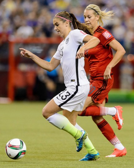 Alex Morgan #13 of the United States runs ahead of Lena Goessling #20 of Germany in the second half in the FIFA Women's World Cup 2015 Semi-Final Match at Olympic Stadium on June 30, 2015 in Montreal, Canada. (Minas Panagiotakis/Getty Images)