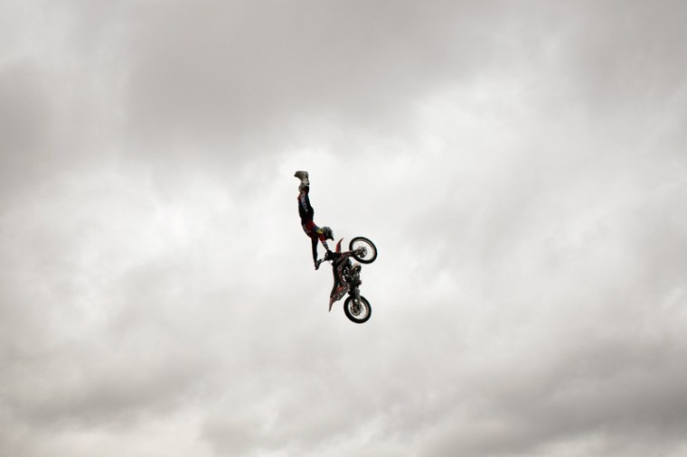 "Freestyle motocross rider Steve Sommerfield jumps his KTM motorbike in London on Tuesday to promote the upcoming ""Night of Jumps"" event on Sept. 5. (LEON NEAL/AFP/Getty Images)"