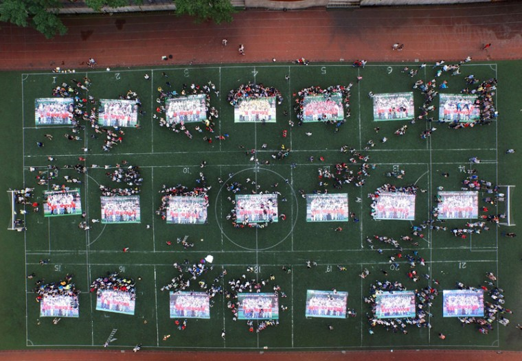 This picture taken on Monday shows high school graduates putting together giant jigsaw puzzles made from their graduation photos on the playground after sitting the 2015 national college entrance examination at a high school in Chongqing. Nearly 10 million high school students sat for China's make-or-break college entrance exams under tight security on Sunday and Monday. (OUTSTR/AFP/Getty Images)