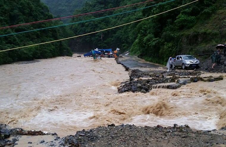 A road is seen damaged by floodwaters in Jianhe county in Qiandongnan, southwest China's Guizhou province on Tuesday. Heavy rainstorms over the past month have left 31 people dead or missing in southwest China's Guizhou Province, local authorities said on Friday. (PHOTOSTR/AFP/Getty Images)