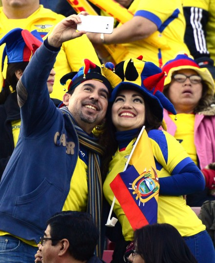 Ecuadorean supporters cheer for their team at the Nacional stadium in Santiago hours before the Copa America kick off, on June 11, 2015. Chile will face Ecuador in the inauguration match. (AFP Photo/Pablo Porciuncula)