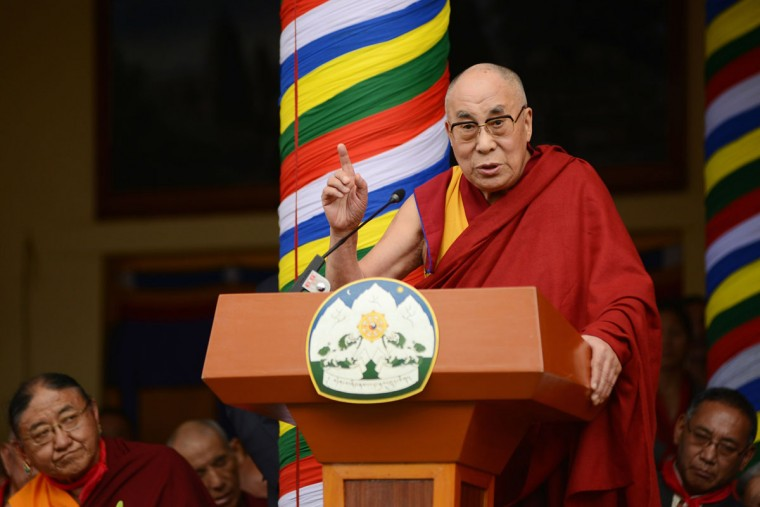 The Dalai Lama (R) speaks at an event to celebrate his 80th birthday at Tsuglakhang temple in McLeod Ganj on June 21, 2015. The Dalai Lama marked his official 80th birthday on June 21, with prayers and celebrations at his hometown in exile but little to show for decades of lobbying for greater Tibetan autonomy. (AFP Photo/P / )