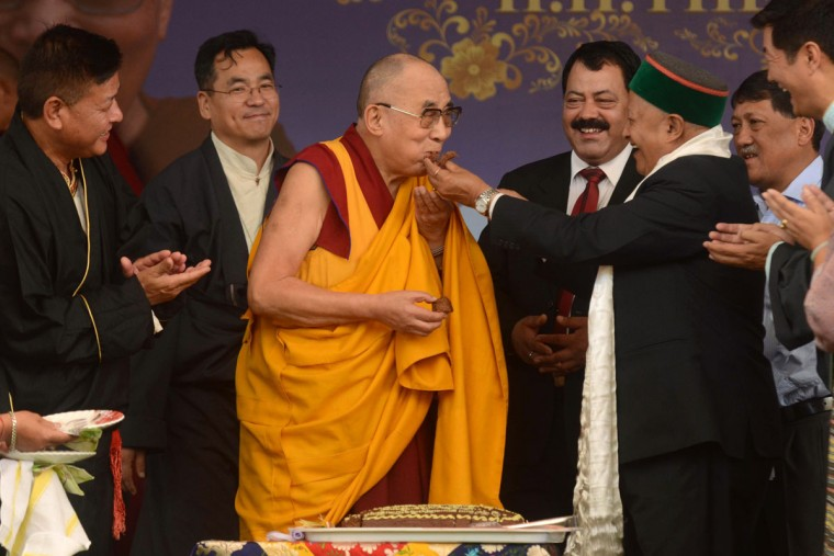 Tibetan Spiritual leader the Dalai Lama (C) is offered cake by The Chief Minister of the northern Indian state of Himachal Pradesh Virbhadra Singh (R) during an event to celebrate his 80th birthday at Tsuglakhang Temple in McLeod Ganj on June 22, 2015. The Dalai Lama marked his official 80th birthday on June 21, with prayers and celebrations at his hometown in exile but little to show for decades of lobbying for greater Tibetan autonomy. (AFP Photo/Narinder Nanu)