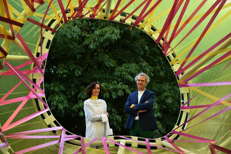 Spanish architects Lucia Cano (left) and Jose Selgas pose by their Serpentine pavilion structure at the Serpentine Gallery in London on June 22, 2015. For the last 15 years the Serpentine gallery has invited artists and architects to produce a temporary structure in the gardens of the gallery. (BEN STANSALL/AFP/Getty Images)