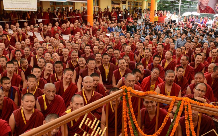 Tibetan Buddhist monks listen to Dalai Lama speaking at an event to celebrate his 80th birthday at Tsuglakhang temple in McLeod Ganj on June 22, 2015. The Dalai Lama marked his official 80th birthday on June 21, with prayers and celebrations at his hometown in exile but little to show for decades of lobbying for greater Tibetan autonomy. (AFP Photo/Narinder Nanu)
