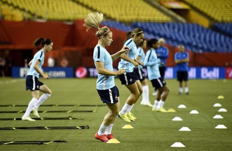 France's forward Eugenie Le Sommer (C) takes part in a training session at the Olympic Stadium in Montreal on June 25, 2015 on the eve of France's 2015 FIFA Women's World Cup quarter-final football match against Germany.  || CREDIT: FRANCK FIFE - AFP/GETTY IMAGES