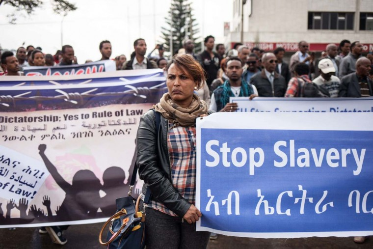 Hundreds of Eritreans demonstrate in front of the African Union HQ in support of the UN Inquiry report and asking for measures to be taken against Eritrea on June 26, 2015 in Addis Ababa. The inquiry's report published earlier this month showed human rights violations in Eritrea that may amount to crimes against humanity, including extrajudicial killings, widespread torture and enforced labour.  || CREDIT: NICHOLE SOBECKI - AFP/GETTY IMAGES