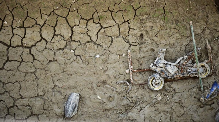 Wreckage of a motor-bike lies on the cracked riverbed of the Amadorio reservoir in Villajoyosa near Alicante where the water is far below usual levels due to drought, on June 25, 2015.  || CREDIT: JOSE JORDAN - AFP/GETTY IMAGES