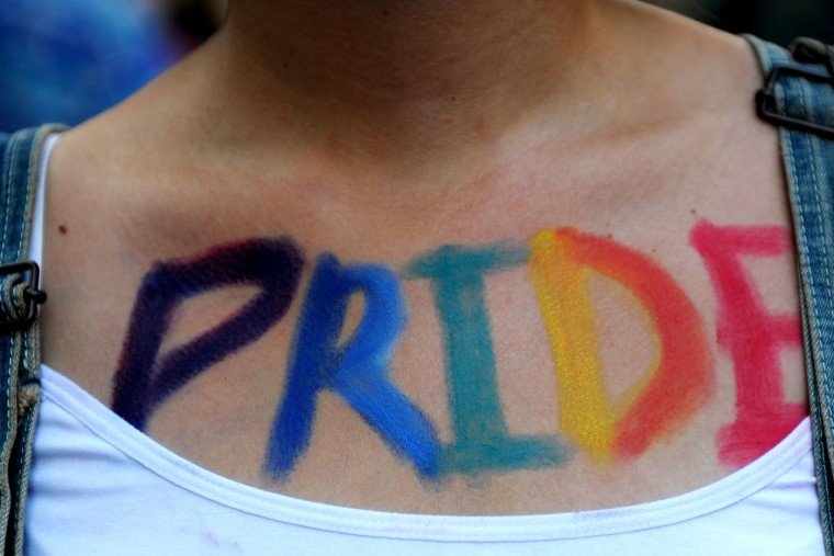 "A woman takes part in the Gay Pride parade with the word ""Pride"" painted on her body on June 28, 2015 at the Cihangir neighborhood near the Taksim square in Istanbul. Riot police in Istanbul used teargas and water cannon to disperse thousands of participants in the Gay Pride parade in the Turkish city, an AFP reporter said. Police took action against the crowd when demonstrators began shouting slogans accusing the social conservative President Recep Tayyip Erdogan of ""fascism"". (Ozan Kose/AFP/Getty Images)"