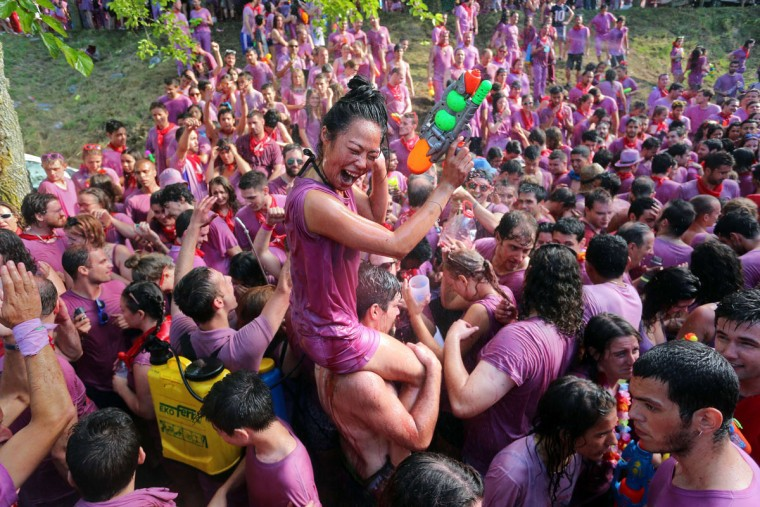"""Covered in wine, revelers enjoy the """"Batalla del Vino"""" (Battle of Wine) in Haro, on June 29, 2015. (CESAR MANSO/AFP/Getty Images)"""