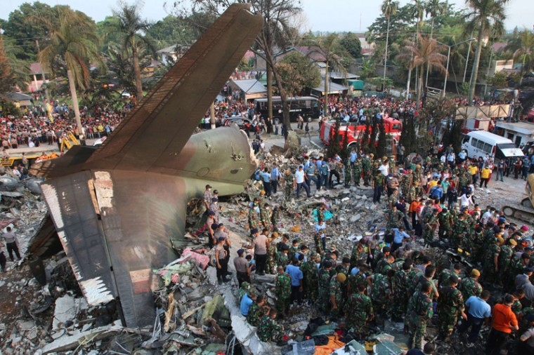 Indonesian search and rescue teams work at the site of an Indonesian military C-130 Hercules aircraft crash in Medan on Tuesday. An Indonesian military transport plane crashed on shortly after take-off in a city on Sumatra island, exploding in a ball of flames in a residential area. (KHARISMA TARIGAN/AFP/Getty Images)