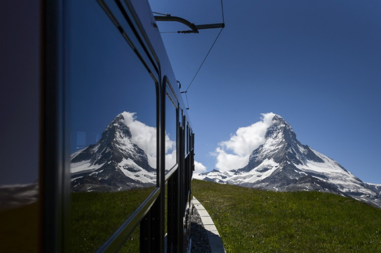 The Matterhorn mountain is seen in reflexion from the Gornergrat train on Tuesday in Riffelalp above Zermatt. The alpine resort celebrates this year the 150 anniversary of Matterhorn's first climb. On July 14, 1865, British climber Edward Whymper reached the peak of the Matterhorn (14,691 feet) together with his rope team. (FABRICE COFFRINI/AFP/Getty Images)