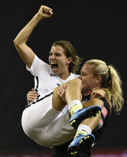 USA midfielder Tobin Heath (L) and goalkeeper Ashlyn Harris (R) celebrate winning their semi-final football match against Germany during the 2015 FIFA Women's World Cup at the Olympic Stadium in Montreal on June 30, 2015. (Franck Fife/AFP/Getty Images)