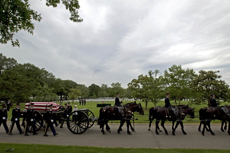 An army caisson team carries a casket containing the remains of four soldiers missing from Vietnam War: Army Chief Warrant Officer 3 James L. Phipps, Army Chief Warrant Officer 3 Rainer S. Ramos, Army Staff Sgt. Warren Newton, Army Spc. Fred J. Secrist, during a group burial services at Arlington National Cemetery in Arlington, Va. (Jose Luis Magana/AP photo)