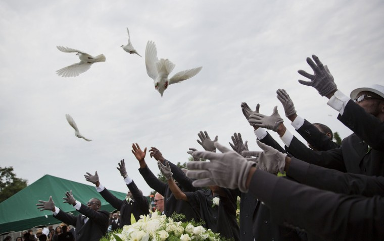 Pallbearers release doves over the casket of Ethel Lance during her burial service, Thursday, June 25, 2015, in Charleston, S.C. Lance was one of the nine people killed in the shooting at Emanuel AME Church in Charleston last week. (AP Photo/David Goldman)